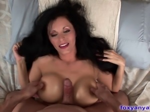 Stunning Foxy Anya seductively sucks cock before climbing on top and sliding...