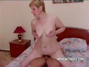 Hairy blonde milf rides a young stud's cock