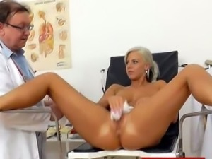 Freaky doctor stretches wet pussy