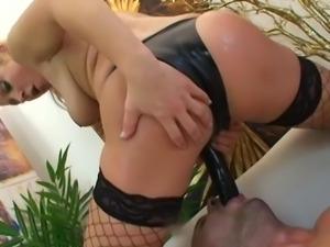 blonde shoves black strap down dude's throat