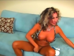 Smoking hot tanned shemale cougar Ariel Everits with big firm hooters and...