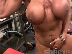 Mature muscle maven Rhonda Lee Quaresma works he body in the SheMuscle gym...