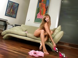 With tiny tits shows it all as she plays with her wet hole