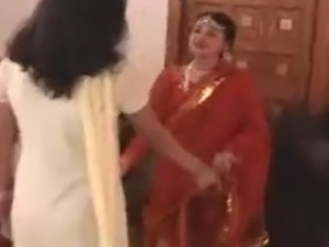 Two Indian girls in elaborate sarees are chilling, talking when their Madam...
