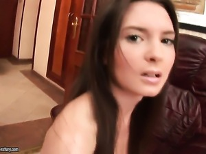 Brunette fills the hole between her legs with dildo for cam in solo scene