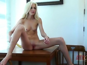 Blonde Emily Kae with tiny tities and smooth bush demonstrates her nice wet...