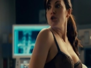 Erica Durance straddling a guy on a hospital bed and pulling her shirt off to...