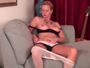 Mommies rubs her hairy pussy