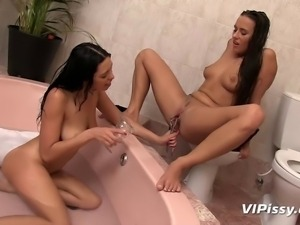 Mea and Kira shower each other in their hot piss and then bathe in the fresh...