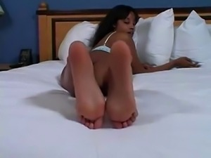 Black girl's soles on the bed