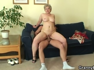 Mature blonde sucks and rides a hard rod of meat