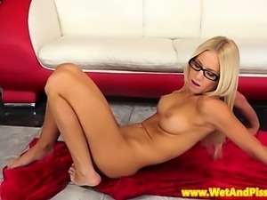 Blonde pissing babe in glasses close up