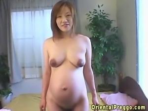 Oriental preggo plays with her tits