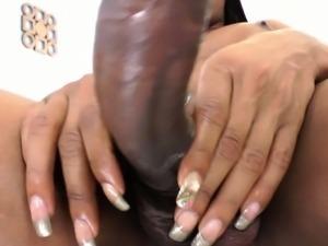 Solo ebony tgirl tugs on her hard cock
