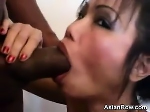 Thai Whore Sucking On A Big Black Cock