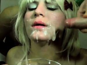 Blonde on knees empties dicks of hot jizz
