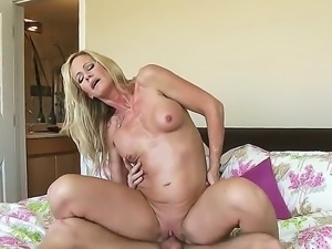 Good looking milf blonde Simone Sonay with fake boobs and shaved snatch shows...