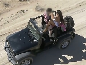 Busty Mercedes Carrera gets in a jeep and takes off her top. She then gets...