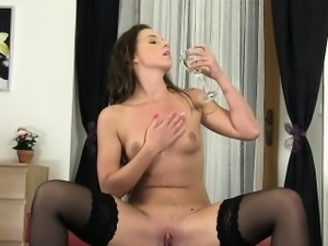 Thin babe pisses in a glass cup
