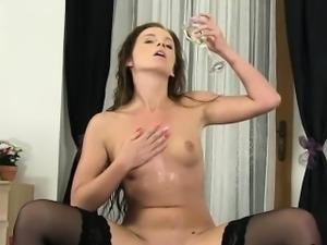 Stockinged Naty Lee self fucking and pissing