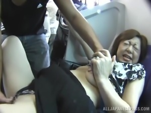 japanese milf gets fingered on the train
