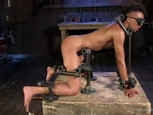 the prisoner of the kinky bondage device