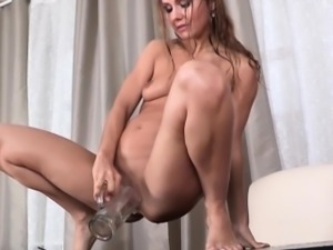 Piss drenched babe rubs her pussy
