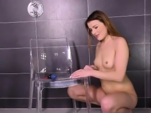 Cute looking girl toys her piss soaked pussy