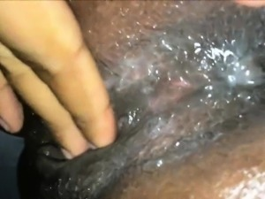 Black pussy releases a river of pussy juices