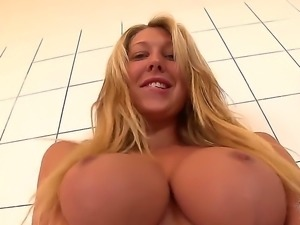 Lexi Lowe is a blonde with large tits. She is getting undressed to reveal...