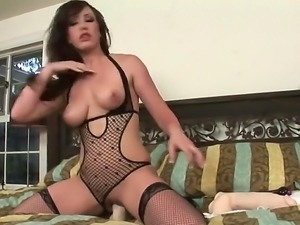 Naughty Jennifer White in stockings and stiletto shoes toy fucks her wet cunt...