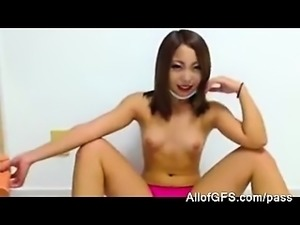 Japanese girl shows her toy