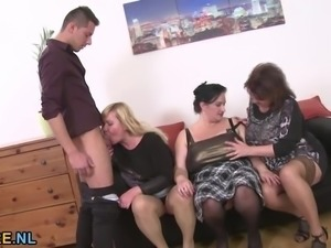 Three mature ladies sharing a young stud