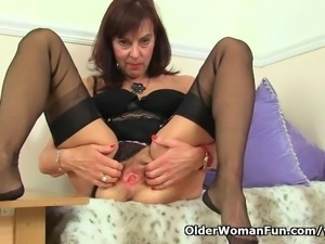 British granny Georgie Nylons fucks herself with a dildo
