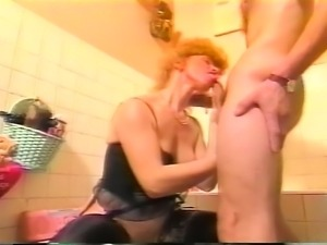 Stacked redhead granny in black stockings has sex with a younger man