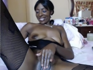 Black lady saggy tits plays with pussy on cam