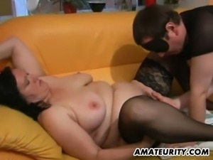 A chubby amateur mom with huge big natural tits sucks a masked...
