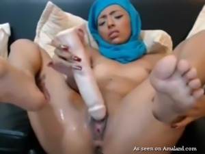 Busty tattooed girl in hijab on her head was trying to satisfy her itching...