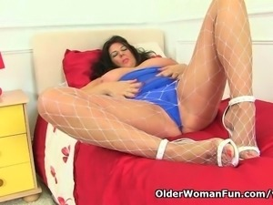 Busty and British milf Lulu Lush loves masturbating in fishnet tights