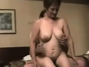 Short haired brunette mom with big hooters jumps on top of