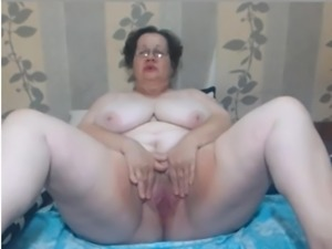 Toothless hairy granny with big tits teases on webcam