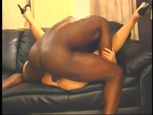 big black and goes with a rubber up the ass