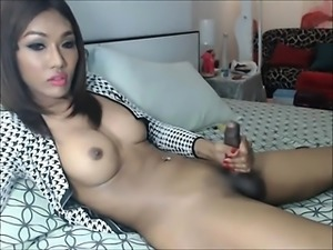 Asian Transsexual jerks off
