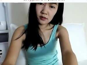 Long-legged young chick strokes her soft muff over her pant