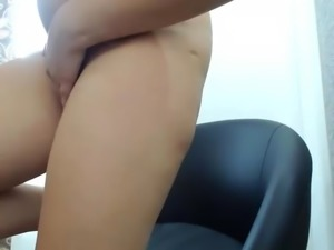 Very pretty girl rubs her pussy until she squirts