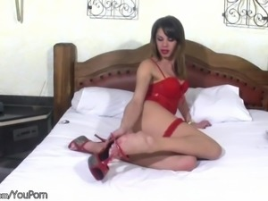 T-girl in red lingerie enjoys juicy fruit and her large cock