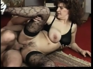 Big breasted mature woman reveals her naughty side with a younger man