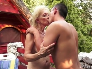 Plump pussy lips granny and her man fucking outdoors