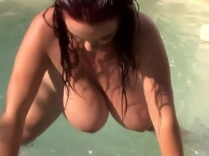 chubby big titted lady topless in the pool