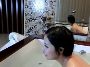 Chinese slut taking a bath with a webcam.